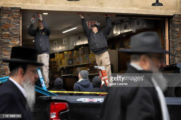 Recovery and clean up crews work the scene in the aftermath of a mass shooting at the JC Kosher Supermarket on December 11 2019 in Jersey City New...