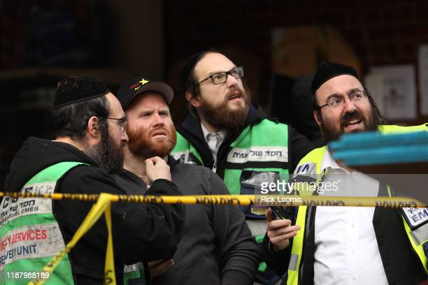 Recovery and clean up crews work the scene in the aftermath of a mass shooting at the JC Kosher Supermarket on December 11, 2019 in Jersey City, New...