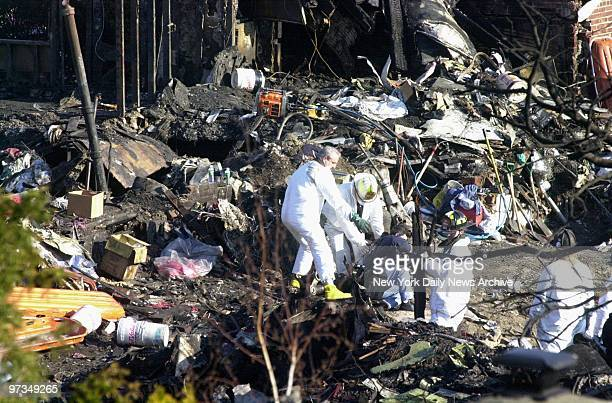 Recovery teams continue the search for bodies at the crash scene of American Airlines Flight 587 The Airbus A300 went down in Belle Harbor Queens...