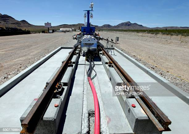 A recovery vehicle and a test sled sit on rails after the first test of the propulsion system at the Hyperloop One Test and Safety site on May 11...