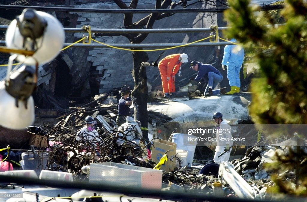 Recovery workers examine parts of the Airbus A300 which cras : News Photo