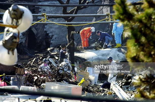 Recovery workers examine parts of the Airbus A300 which crashed in Belle Harbor Queens Monday morning American Airlines Flight 587 went down shortly...