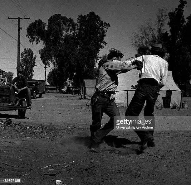 Recreation in a migratory agricultural workers' camp near Holtville California by Dorothea Lange 18951965 dated 19390101