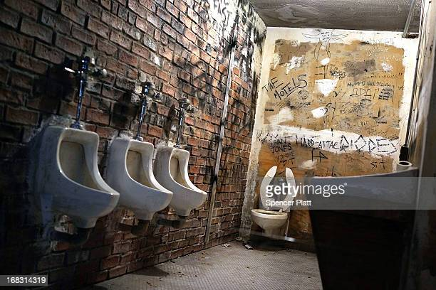 A recreation of the CBGB bathroom is viewed at the Metropolitan Museum of Art's Spring 2013 Costume Institute exhibition entitled 'PUNK Chaos to...