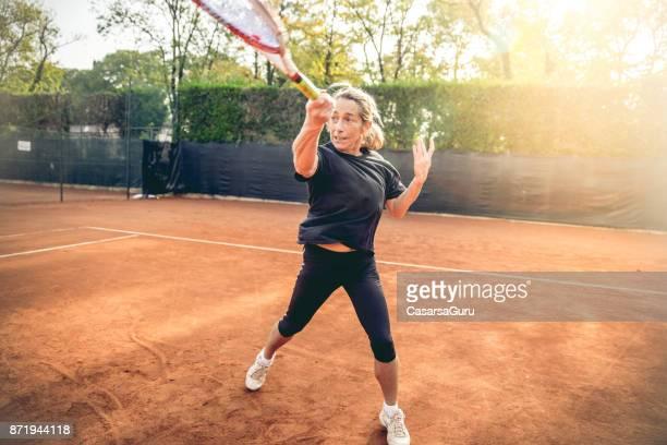 Recreational Adult Female Swinging a Racket