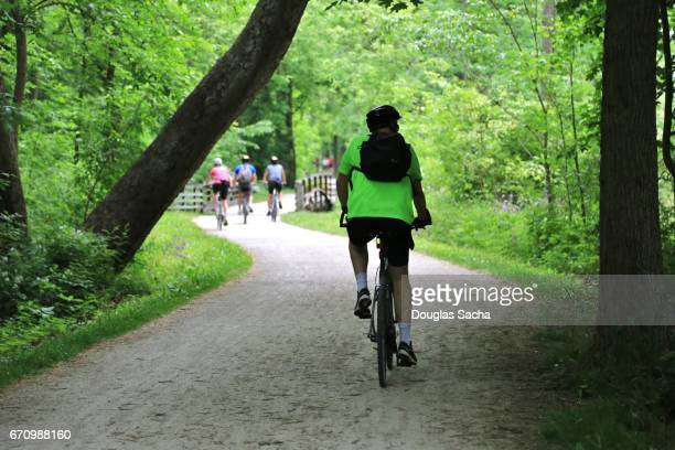 recreational bicycling on the trail - cuyahoga river stock photos and pictures