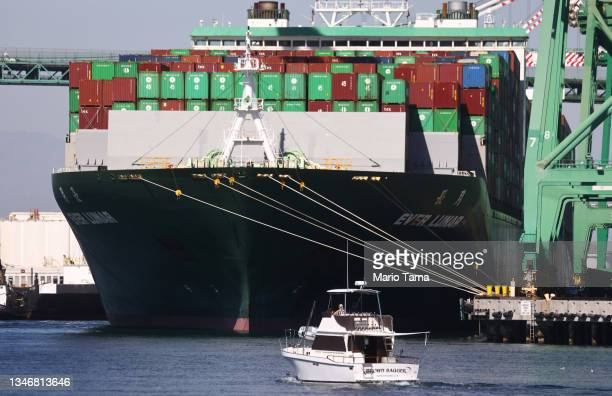 Recreational boat passes near the Ever Lunar container ship at the Port of Los Angeles, the nation's busiest container port, on October 15, 2021 in...