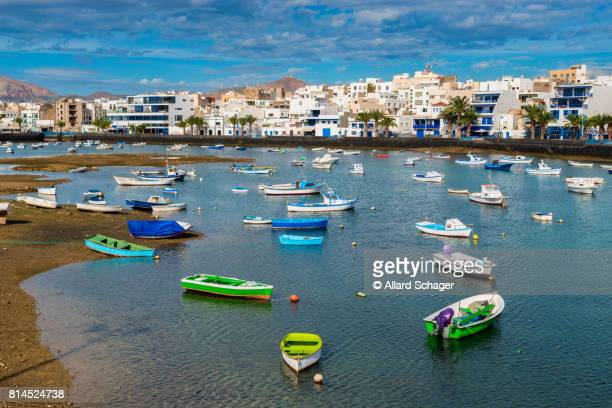 recreational boats in harbor of arrecife lanzarote - low tide stock pictures, royalty-free photos & images