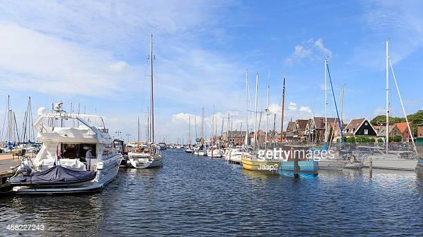 recreational boats in sunny harbor of urk, the netherlands - flevoland stockfoto's en -beelden