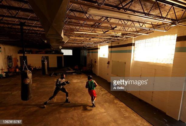 Recreational boxer Raheem Yusuff spars with Amateur Kickboxer Sal Carillo during a final boxing workout at Jetty gym on July 30 2020 in Oceanside New...