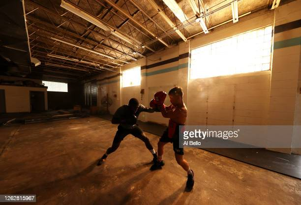 Recreational boxer Raheem Yusuff spars with New York Golden Gloves boxer Dennis Guerrero during a final boxing workout at Jetty gym on July 30 2020...