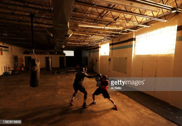 Recreational boxer Raheem Yusuff spars with three time New York Golden Gloves boxer Anthony Lopez during a final boxing workout at Jetty gym on July...