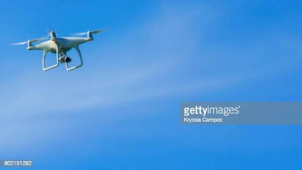 Recreational Drone (Quadcopter) against blue sky, copy space