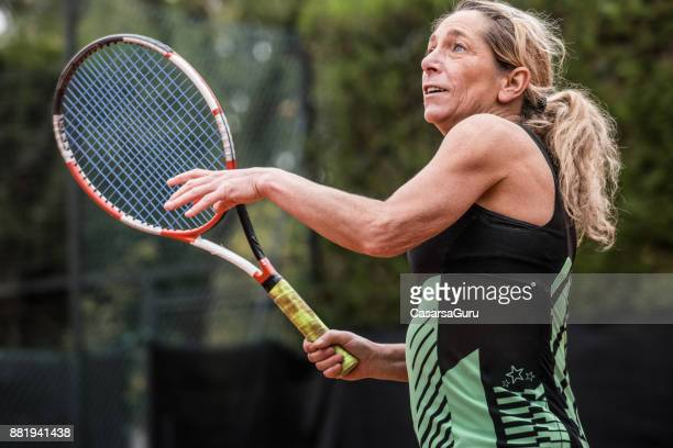 Recreational Female Tennis Player Holding a Racket