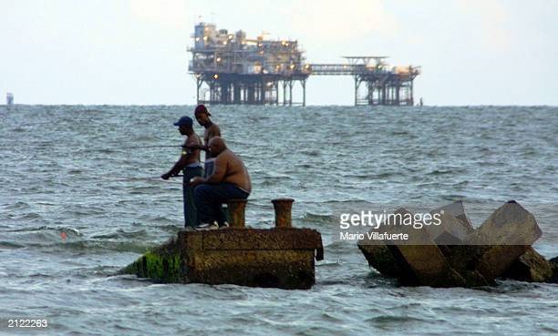 Recreational fishermen cast their lines from break water barges set yards from the beach June 28 2003 at Port Fourchon Louisiana The barges were...
