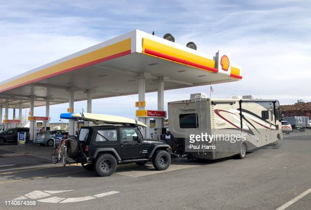 Recreational vehicle stops for gas and is fully prepared for a road trip with an RV, Jeep, Kayak and bicycles April 4 2019, Kingman, Arizona