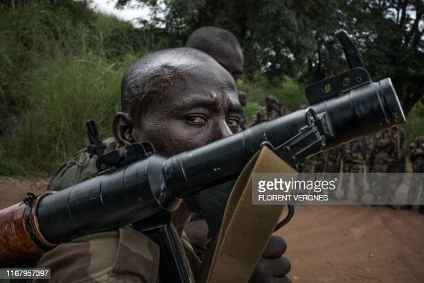 Recruit carries an anti-tank weapon during a training session at the Camp Leclerc base in Bouar, some six hundred kilometers northwest from the...