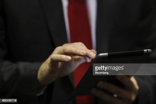 A recruiter uses an Apple Inc iPad during a Job News USA career fair in Overland Park Kansas US on Wednesday March 8 2017 Applications for US jobless...