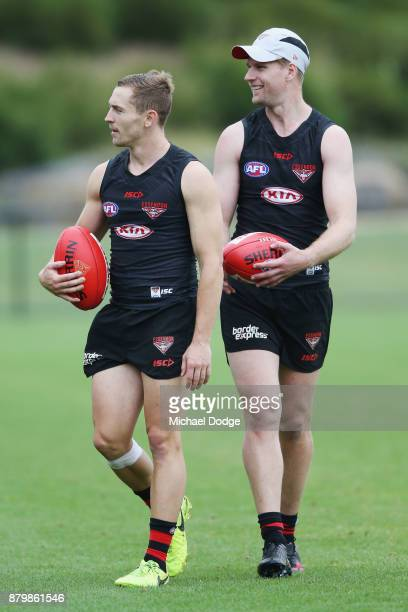 Recruits Devon Smith and Jake Stringer look upfield during an Essendon Bombers AFL training session at the Essendon Bombers Football Club on November...
