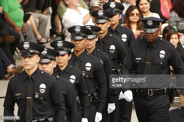 Recruits fall into rank as the Los Angeles Police Department holds a graduation ceremony for 37 officers led by LAPD Chief Charlie Beck and Mayor...