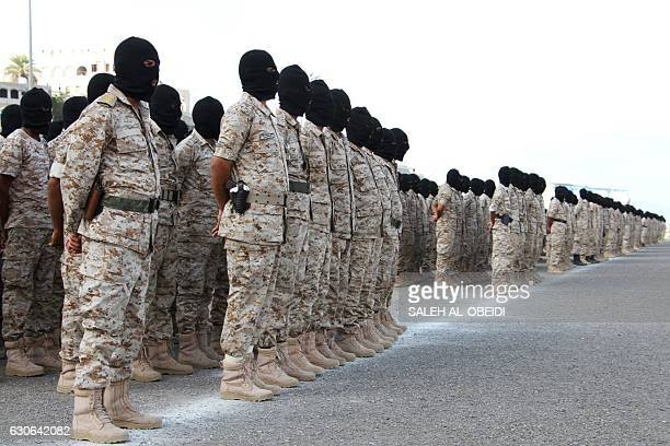 Recruits from the Yemeni counterterrorism forces stand to attention during a graduation ceremony on December 29 in the southern city of Aden / AFP /...