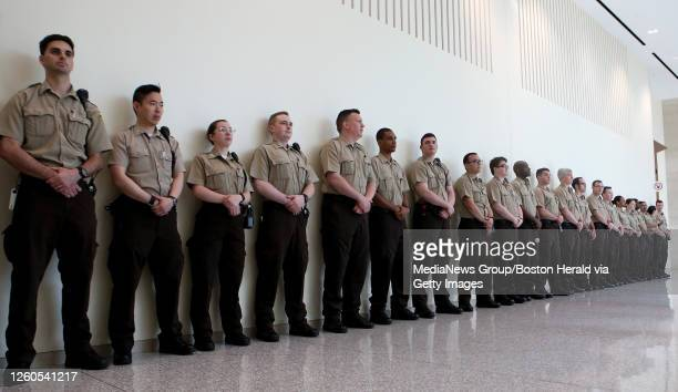 Recruits line the hallway outside the courtroom where Julie Tejeda appeared in the docket, after allegedly stabbing an EMT, at Boston Municipal Court...