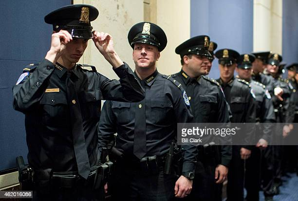 Recruits line up in a side hallway before the start of the US Capitol Police graduation ceremony for the 35 members of Recruit Officer Class in the...