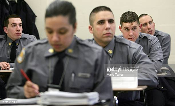 Recruits listen during a police law class at the New York City Police Academy April 6 2006 in New York City Recruits are trained in firearms and...