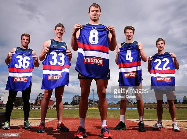 Recruits Matt Fuller Sam Darley Stewart Crameri Marcus Bontempelli and Mitch Honeychurch pose with their new guernseys during a Western Bulldogs AFL...