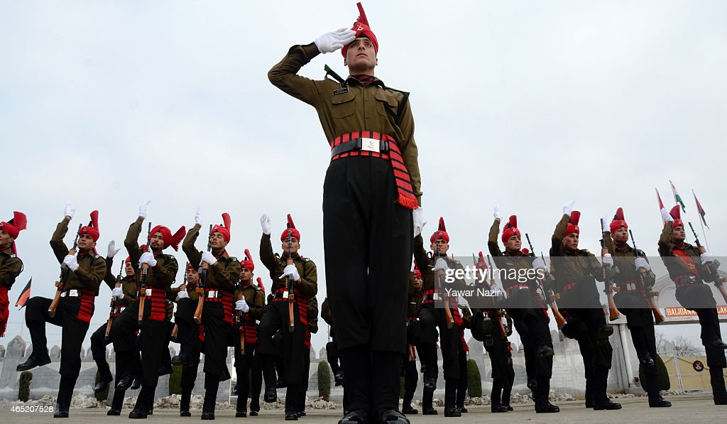 Recruits of Indian army from Kashmir salute during their passing out parade at a garrison in Rangreth on March 04, 2015 in the outskirts of Srinagar, the summer capital of Indian-administered Kashmir, India. Over 175 Kashmiri men took an oath during their passing out parade after successfully completing 49 weeks of arduous training which involved, weapons handling, map reading and counter-insurgency operations. The recruits will join Indian army's Jammu and Kashmir Light Infantry Regiment (JAK LI) to fight militants in Kashmir, a spokesman of the army said. India has already close to a million soldiers posted in Kashmir, making the disputed Himalayan region one of the most militarized zones in the world.