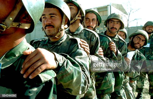 Recruits of the Afghan National Army await their turn to compete in an inter-regimental military skills competition at the Kabul Military Training...