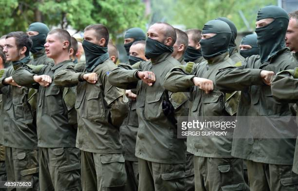 Recruits of the Azov far-right Ukrainian volunteer battalion take their oaths during a ceremony in Kiev, on August 14, 2015. Two people were killed...
