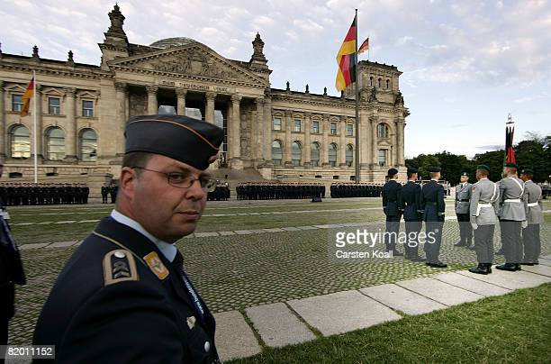 Recruits of the German armed forces the Bundeswehr attend their swearingin ceremony in front of the Reichstag on July 20 2008 in Berlin Germany The...