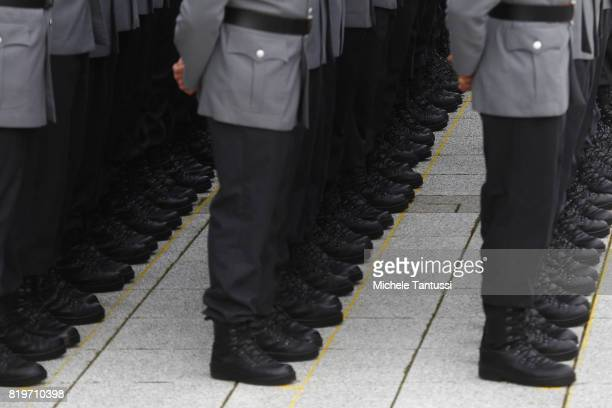 Recruits of the German armed forces the Bundeswehr take their pledge to serve during a swearingin ceremony in the Bendlerblock courtyard at the...