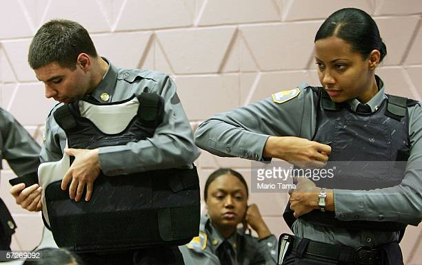 Recruits try on their bulletproof vests at the New York City Police Academy April 6 2006 in New York City Recruits are trained in firearms and...