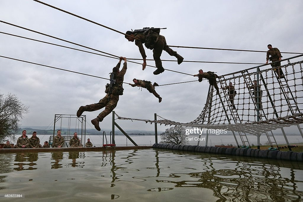 Recruits undergo training at Commando Training Centre Royal Marines on December 01, 2014 in Lympstone, United Kingdom. Recruit training lasts for 32 weeks for Marines and 64 weeks for officers and is one of the longest and most physically demanding specialist infantry training regimes in the world. On the 28th October 2014, the Royal Marines celebrated their 350th birthday year. Since then, Marines have taken part in more battles on land and sea around the world than any other branch of the British Armed Forces.