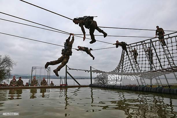 Recruits undergo training at Commando Training Centre Royal Marines on December 01 2014 in Lympstone United Kingdom Recruit training lasts for 32...