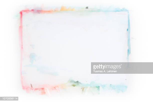 Rectangle shaped stained and colorful watercolor frame on white background. Copy space.