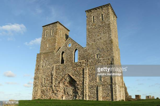 reculver towers a roman saxon shore fort and remains of a 12th century church undercut by coastal erosion. - stone material stock pictures, royalty-free photos & images