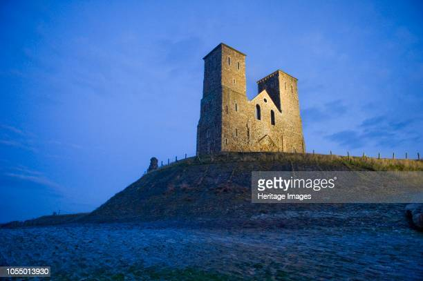 Reculver Towers Kent 2010 Floodlit view of the twin towers with rocks of the coastal defences in the foreground Reculver Towers are the remainder of...