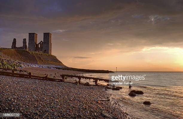 Reculver Towers ruin at sunset taken from the shoreline of the beach, Kent