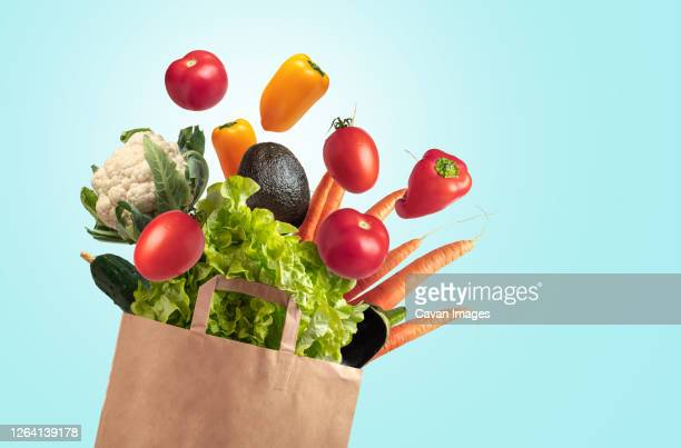recyclable bag of fresh vegetables on blue summer sky background - fruit stock pictures, royalty-free photos & images