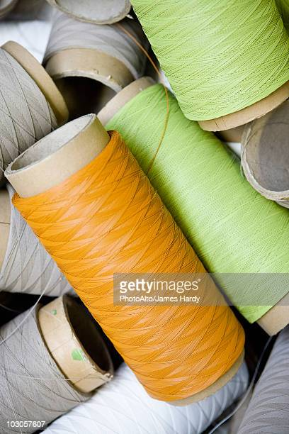 recyclable composite textile fabrication department of factory, reels of excess coated thread - polyester stock photos and pictures