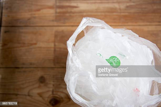 Recyclable plastic shopping bags on wooden floor