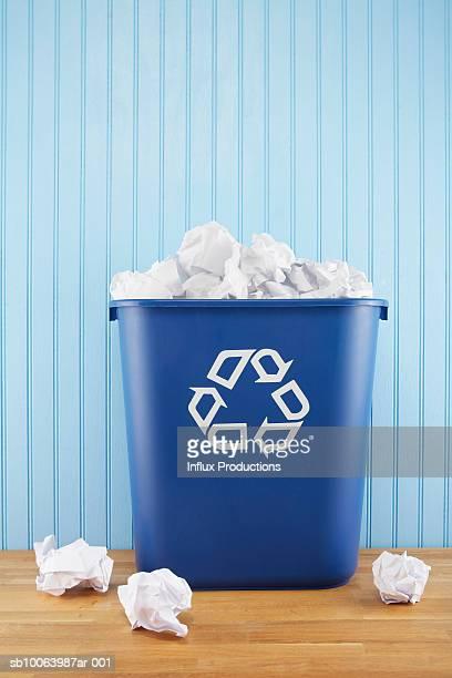 Recycle bin full of paper