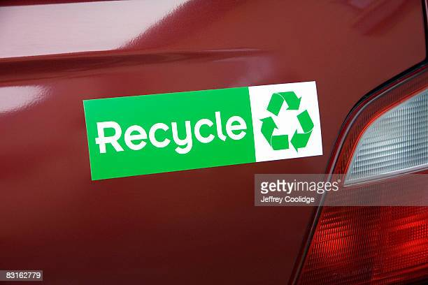 recycle bumper sticker on car - bumper sticker stock photos and pictures