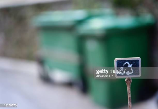Recycle symbol drawn on label + recycle containers