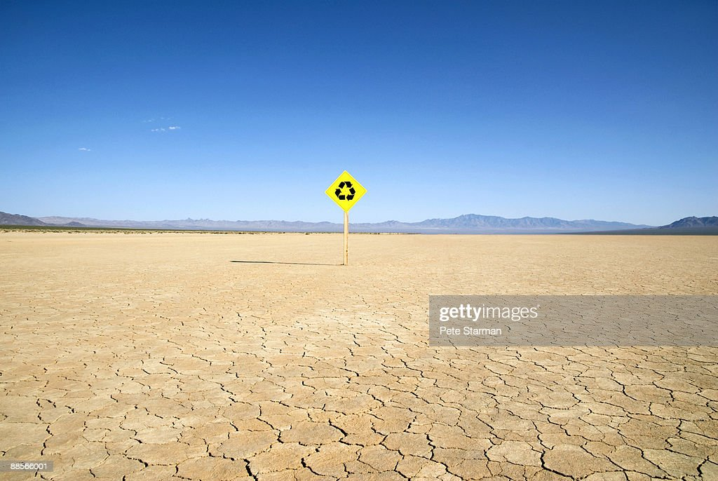 Recycle traffic sign on dry lake bed.  : Stock Photo