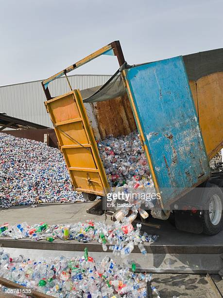 Recycle truck dumping out plastic bottles