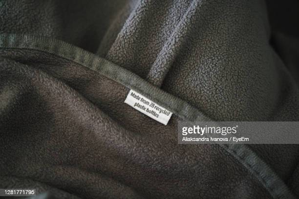 recycled blanket made of plastic bottles - jacket stock pictures, royalty-free photos & images